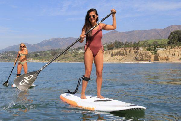2 girls standup paddleboarding