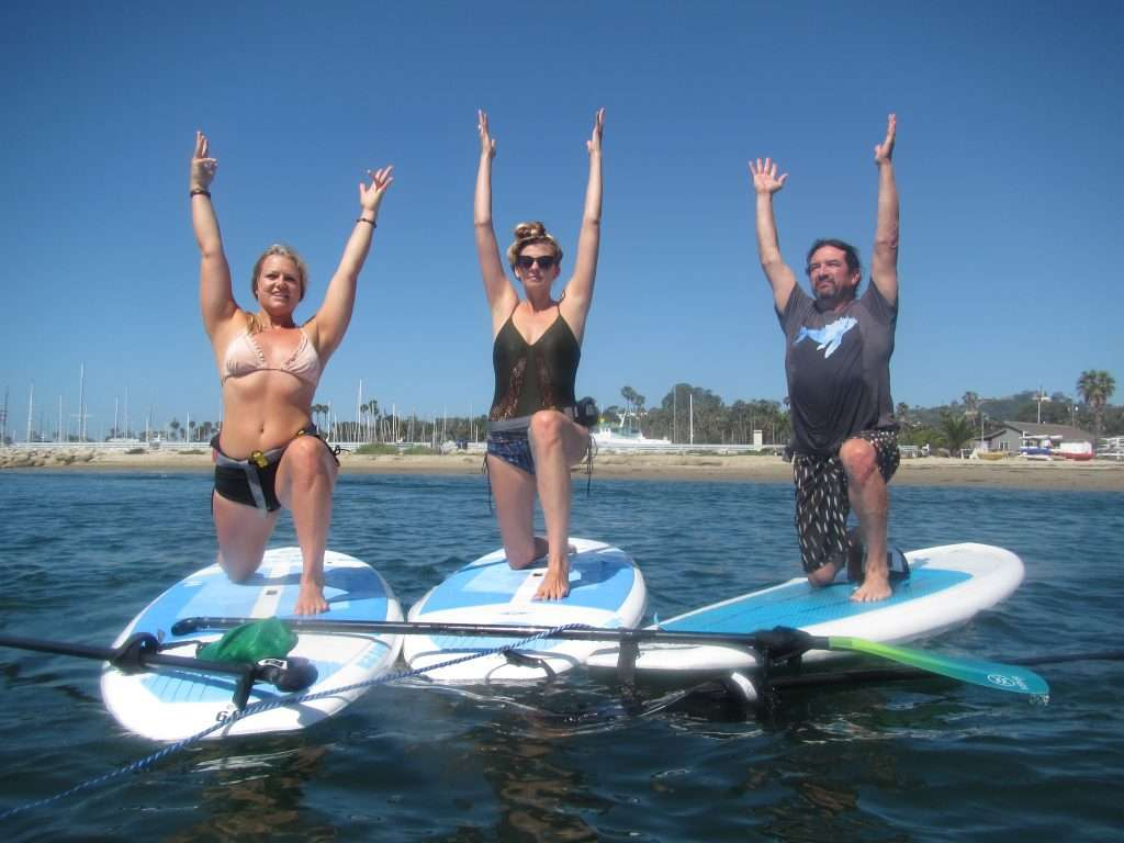 3 people standup paddleboarding