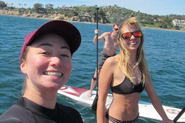 enjoying stand up paddle board lessons