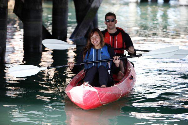 kayaking under a pier