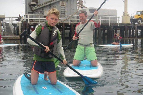 kids learning to paddle board